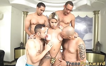 Tranny Latina group-fucked by muscled gang of large rods