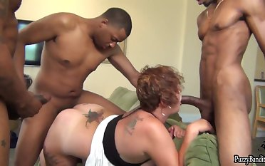 Busty and big bore BBW Scarlet in interracial gangbang with black studs