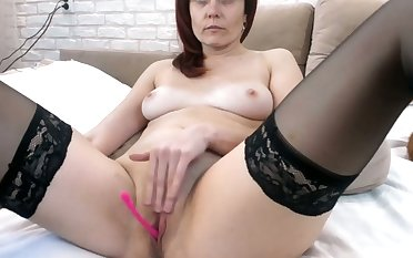 Caught my mother fingering her pink pussy