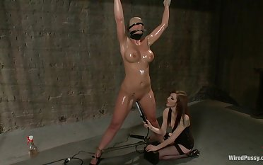 Tied up busty blonde is tied up and fucked by horny feathers Princess Donna Dolore