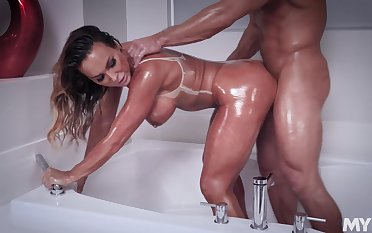 Oiled beauty fucks nigh nonconformist modes to the fore swallowing