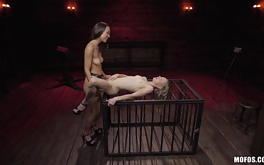 Unveil lesbians share the strap-on in  their first femdom tryout