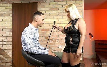 Mature escort mistress Anna Valentina bangs young submissive dude